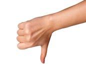 Pulgar de la mano de la mujer abajo aislado en el fondo blanco Símbolo del rechazo Imagen de archivo libre de regalías