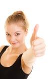 Pulgar de la mujer del deporte de la aptitud encima del gesto de mano de la muestra Foto de archivo libre de regalías