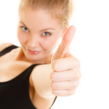 Pulgar de la mujer del deporte de la aptitud encima del gesto de mano de la muestra Imágenes de archivo libres de regalías