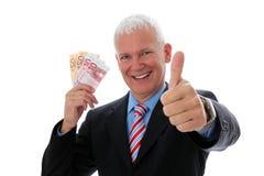 Pulgar del dinero del hombre de negocios para arriba Foto de archivo