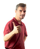 Pulgar del hombre joven ascendente y sonrisa aislada en blanco Fotos de archivo