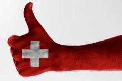Pulgar encima de Suiza Fotografía de archivo