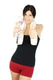 Pulgar hermoso de la muchacha del deporte para arriba con la botella de agua Fotos de archivo libres de regalías