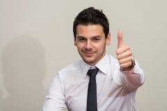 Pulgar joven de Executive Has The del hombre de negocios para arriba Fotos de archivo