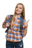Pulgar que muestra turístico femenino joven para arriba Fotografía de archivo