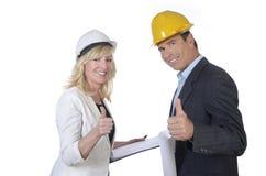 Pulgar sonriente del arquitecto de sexo masculino y de sexo femenino para arriba Imagen de archivo libre de regalías