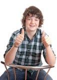 Pulgares adolescentes para arriba Imagenes de archivo