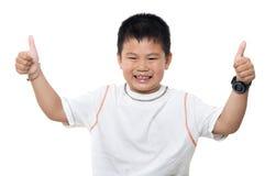 Pulgares asiáticos del muchacho para arriba Imágenes de archivo libres de regalías