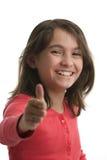 Pulgares de la chica joven para arriba Foto de archivo libre de regalías
