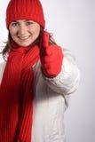 Pulgares de la mujer para arriba en ropa del invierno Foto de archivo
