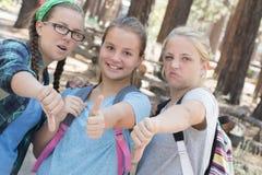 Pulgares de las muchachas Imagen de archivo