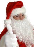 Pulgares de Papá Noel para arriba Fotos de archivo