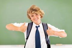 Pulgares del adolescente para arriba Foto de archivo libre de regalías