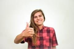Pulgares del adolescente para arriba Imagen de archivo libre de regalías
