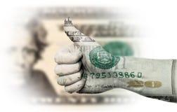Pulgares hasta el dólar americano Foto de archivo