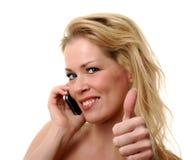 Pulgares para arriba en el teléfono Fotografía de archivo libre de regalías