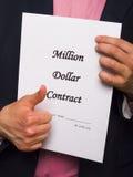 Pulgares para arriba en un contrato Foto de archivo libre de regalías