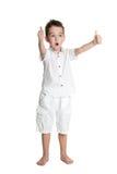 ¡Pulgares para arriba! Retrato del niño pequeño hermoso alegre feliz Fotos de archivo libres de regalías