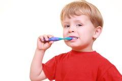 Pulisca i denti Immagine Stock