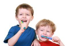 Pulisca i denti Immagini Stock