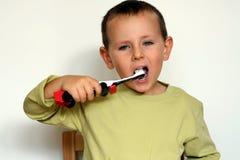 Pulisca i denti Fotografia Stock