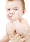 Pulisca il neonato in mani della madre Fotografia Stock