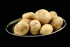 Pulisca le patate Fotografie Stock