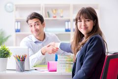 Pulisher discussing book order with customer. Publisher discussing book order with customer Stock Photo
