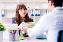 Pulisher discussing book order with customer. Publisher discussing book order with customer Royalty Free Stock Photo