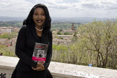 THE PULITZER ISABEL WILKERSON IN ITALY. Isabel Wilkerson, in front of the Brufani Hotel, Perugia, during the International Journalism Festival, presenting her Royalty Free Stock Photos