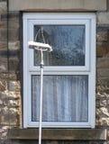 Pulizia di finestra Immagini Stock