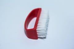 Pulizia di spazzola rossa Fotografia Stock