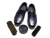 Pulizia scarpe su bianco Fotografie Stock
