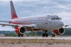 Aircraft Airbus A320 of Rossiya Airlines is taxi on the runway stock images