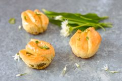 Pull apart bread roll. Three apart bread roll with ramsons and herbs stock images