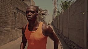 slow motion of young attractive and fit black African American sport man running, an athletic professional runner training hard stock footage