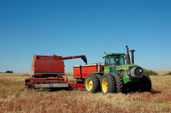 Pull Combine Dumping Grain Royalty Free Stock Photos
