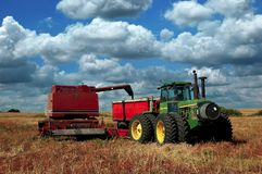 Pull Combine dumping harvest Royalty Free Stock Photography