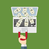 Pull Down Money From Internet With Magnet. Man holding magnet and pull down the bunch of money from laptop screen Royalty Free Stock Images