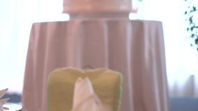 Pull focus of wedding cake in an interior hotel settings stock video footage