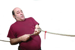 Pull Hard. When you're in a tug of war you pull hard, over white Stock Photography