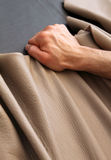 Pull lose leather particular. A person work leather to make a sofa stock photo