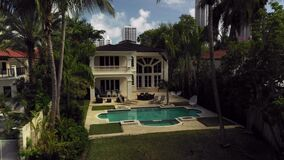 Pull out shot revealing a mansion with swimming pool Miami 4k
