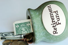 Pull out some money from the Retirement Fund jar Stock Photos