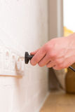 Pull the plug concept with man pulling black cord and plug Royalty Free Stock Photo
