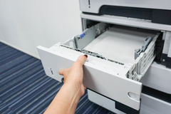 Pull printer tray by woman. Pull printer tray check the paper inside Stock Photo