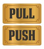 Pull and push - gold door signs Stock Images