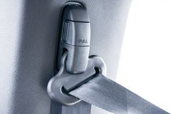 Pull safety belt in car stock photography