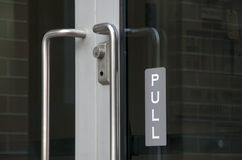 Pull sign at glass door Stock Photography