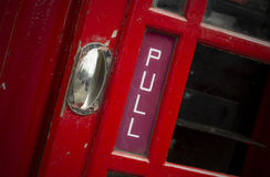 Pull sign on old telephone box Royalty Free Stock Images